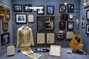"Photograph of the Faron Young exhibit and his connection to Willie Nelson and ""Hello Walls"" on display at the Willie Nelson and Friends Museum."