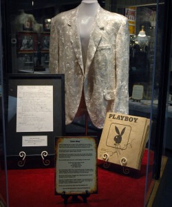 A photo of Ronnie Milsap's performance jacket, hit song and braille Playboy magazine on display at the Willie nelson and Friends Museum.