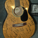 One of our exhibits on display - A signed guitar by some of the many stars who have hung out at the Willie Nelson museum!