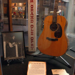 Photograph of exhibits on display Willie Nelson's guitar used on his Grand Ole Opry debut in November of 1963.