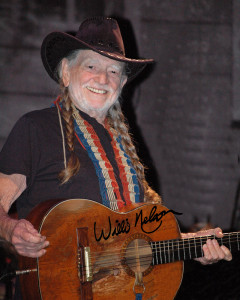 "A great photograph of Willie Nelson and his guitar ""Trigger"" performing on stage at the Ryman Auditorium in Nashville, TN."