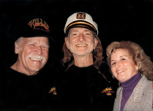 Willie Nelson alongside store founders Jeanie and Frank Oakley in Nashville, TN.