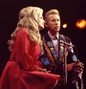 A photo of Porter Wagoner singing with his great partner Dolly Parton during the peak of their duet career together.