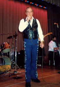 Photograph of The singing sheriff, Faron Young, performing on stage in Nashville at one of his many concerts.