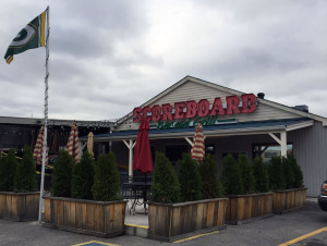 The Scoreboard Bar & Grill featuring fresh smoked BBQ and the coldest beer in town.