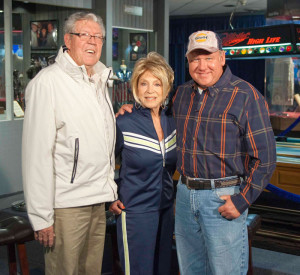 Photograph of Grand Ole Opry star Jeannie Seely alongside husband, Gene Ward and TV host Kenny Dean in the Willie Nelson and Friends Museum in Nashville, TN.