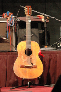 """Willie Nelson's guitar """"Trigger"""" on stage and ready for the show."""