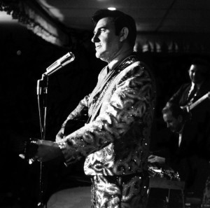 A photograph ofWebb Pierce singing at a club in Atlanta , GA in 1968 wearing a Nudie suit now on display at the Willie Nelson and Friends Museum in Nashville.