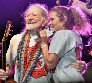 A photograph of Willie Nelson with his Annie celebrating Willie Nelson's 80th birthday.