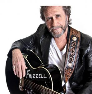 Photograph of David Frizzell with his guitar.