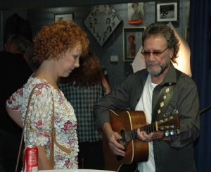 A photograph of David Frizzell playing guitar with Shelly West at the Willie Nelson and Friends Museum in Nashville, TN.