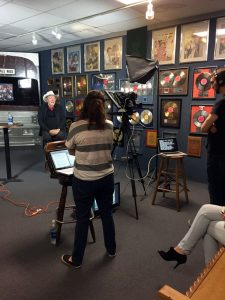 Photograph of Bobby Bare taping a TV show interview at the Willie Nelson and Friends Museum.