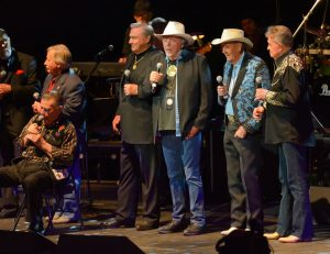 """Photograph of Bobby Bare on stage at the George Jones Tribute Concert along with Stonewall Jackson, John Conlee, Jim Ed Brown, Bobby, Jimmy C. Newman and the great """"Whispering Bill"""" Anderson."""
