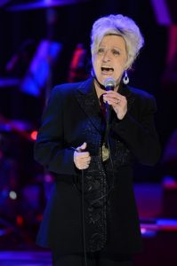 Photograph of Connie Smith singing during a performance at the Country Music Hall of Fame Medallion Ceremony in 2013.