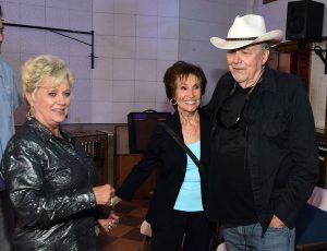 Photograph of Connie Smith backstage with musician friends Jan Howard and Bobby Bare.