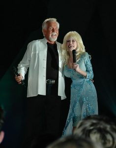 "Photograph of Dolly Parton and Kenny Rogers singing their great hit song, ""Islands in the Stream"" at the CMA awards in Nashville, TN."