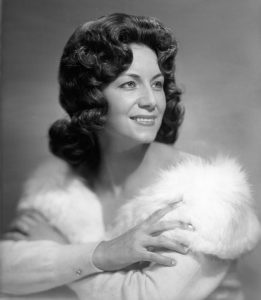 A photograph of Dottie West as a young woman.