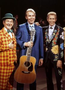 Photograph ofHank Williams, Jr. with Porter Wagoner and Speck Rhodes on the set of Porter Wagoner's TV show before he had the bad fall in a mountain climbing accident.