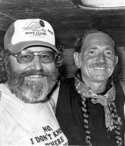 A photograph of Great friends Hank Cochran and Willie Nelson backstage together after a concert.
