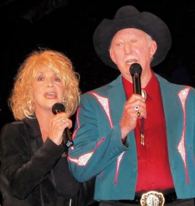 Photograph of Jack Greene and Jeannie Seely performing during one of their many shows together.
