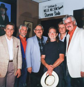 Photograph of J.D. Sumner along with Willie Nelson and members of the Stamps quartet at the Willie Nelson Museum.