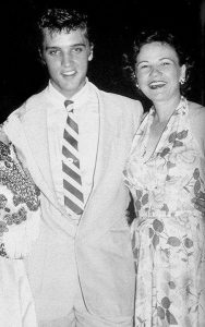 A photograph of songwriter Mae Axton and Elvis Presley together at a show.