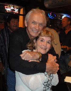 Photo of Mel Tillis and Jeanie Oakley Willie Nelson Museum co-founde) together at Mels's 80th birthday bash party at Honky Tonk Central in Nashville, TN.