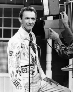 Image of Mel Tillis on the Porter Wagoner TV Show wearing a Nudie suit in the 1960s.