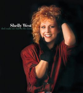 Photo of Shelly West wearing a red dress and black gloves from the cover of her greatest hits CD.