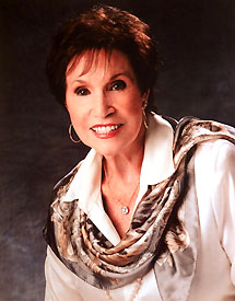 Photograph of Jan Howard with scarf and blouse.