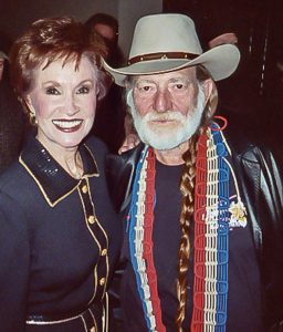 Photograph of Jan Howard and Willie Nelson together backstage in Nashville, TN.
