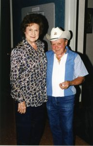 Photo of Grand Ole Opry star Little Jimmy Dickens backstage with the queen of Country Music Kitty Wells.