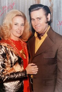 Photograph of Tammy Wynette and George Jones in suits when they were husband and wife in the 1970s.