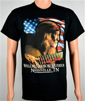 """A great t shirt image of Willie Nelson playing his famous guitar """"Trigger""""."""