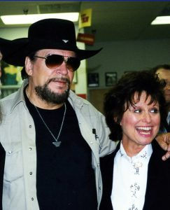 A photograph of Waylon Jennings and wife Jessi Coulter at the Ernest Tubb record shop in Nashville, TN.