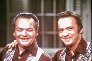 A photograph of the Wilburn Brothers on the set of their Wilburn Brothers TV show shot during the 1960s and 1970s.