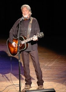 Photo of Kris Kristofferson playing at the Ryman Auditorium in Nashville.