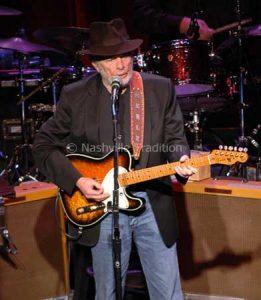 Photo of Merle Haggard performing at the Ryman Auditorium in Nashville, TN.