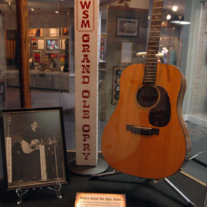 Willie Nelson's 1963 Grand Ole Opry debut guitar and photograph.